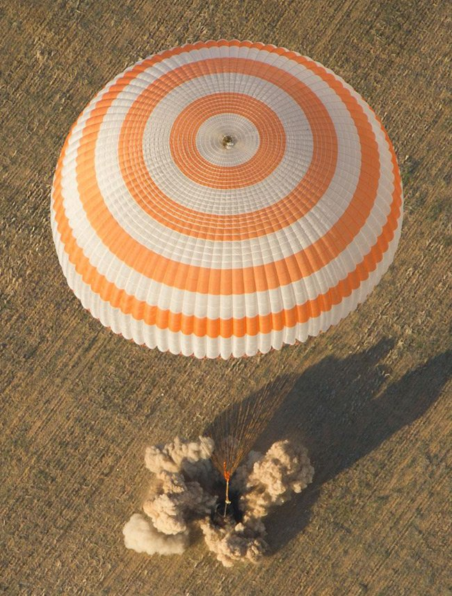 The Soyuz TMA-04M spacecraft is seen as it lands with Expedition 32 Commander Gennady Padalka of Russia, NASA Flight Engineer Joe Acaba and Russian Flight Engineer Sergie Revin in a remote area near the town of Arkalyk, Kazakhstan, on Monday, September 17, 2012. Pic: