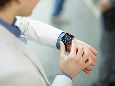 Sony SmartWatch on a cream suit