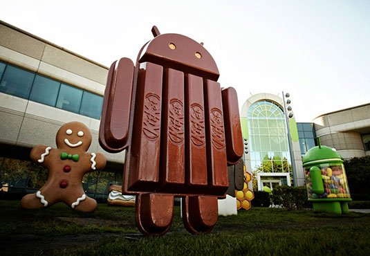 Photo of the KitKat mascot among the Android lawn statues