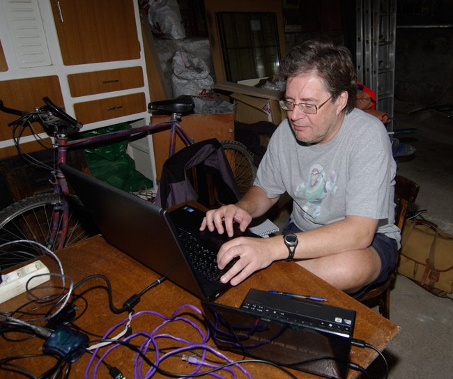 Dave Akerman at the computer inside the workshop