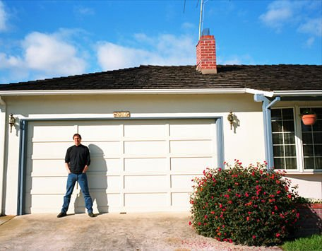 Steve Jobs in front of 2066 Crist Drive, Los Altos, California