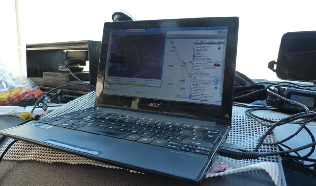 The tracking laptop on the dashboard of the pursuit van