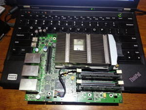 Sentinel DS6100 motherboard against Lenovo Laptop Small