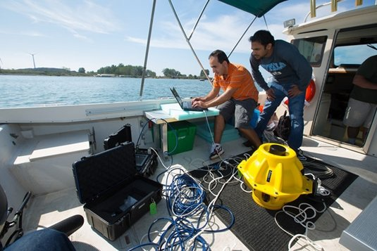 Electrical Engineering Graduate Students Hovannes Kulhandjian and Zahed Hossain of Tommaso Melodia's WINES Lab Research on Lake Erie