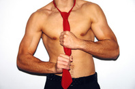 Muscular man stripping off his shirt