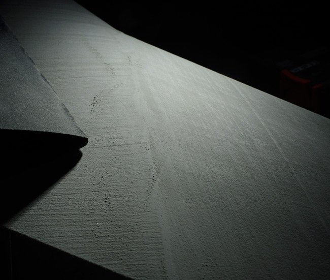 A close-up of the wing surface after sanding and priming