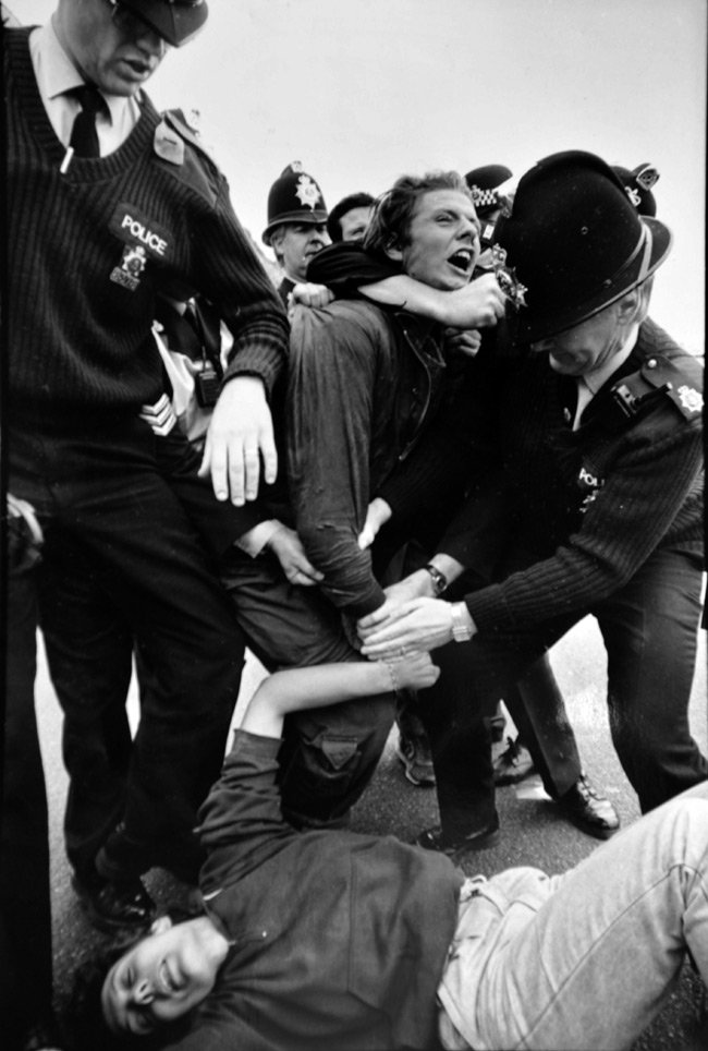 Black and white image by Phil of police battling protesters