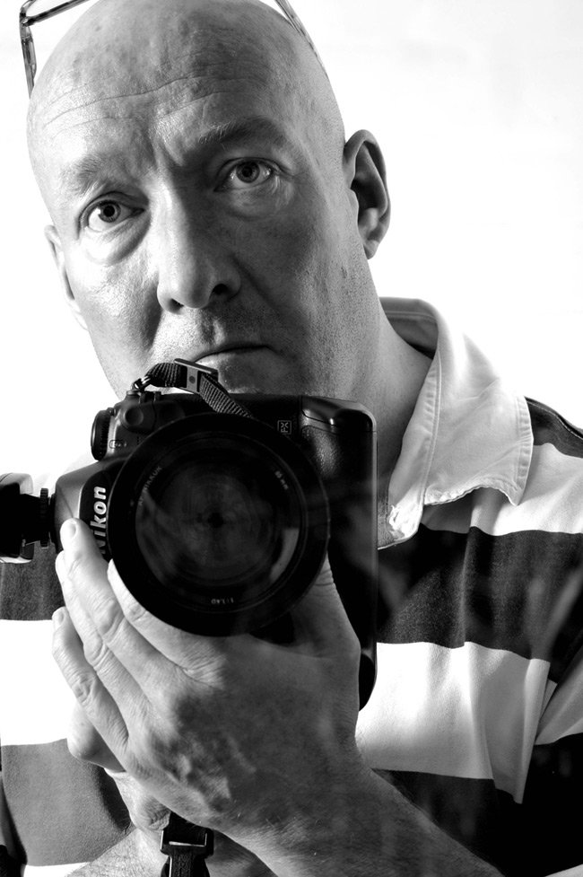 Portrait of Phil Houghton holding mighty Nikon