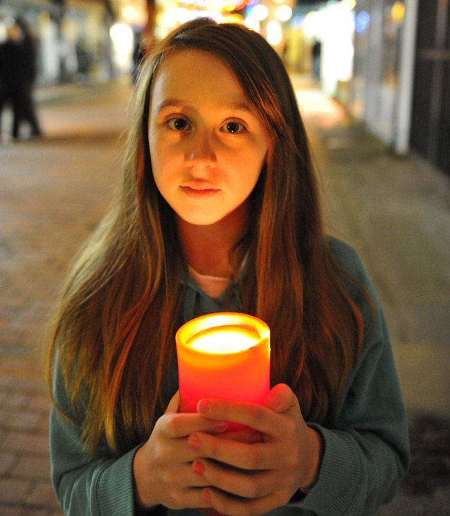 Portrait of Samantha with candle by Phil Houghton