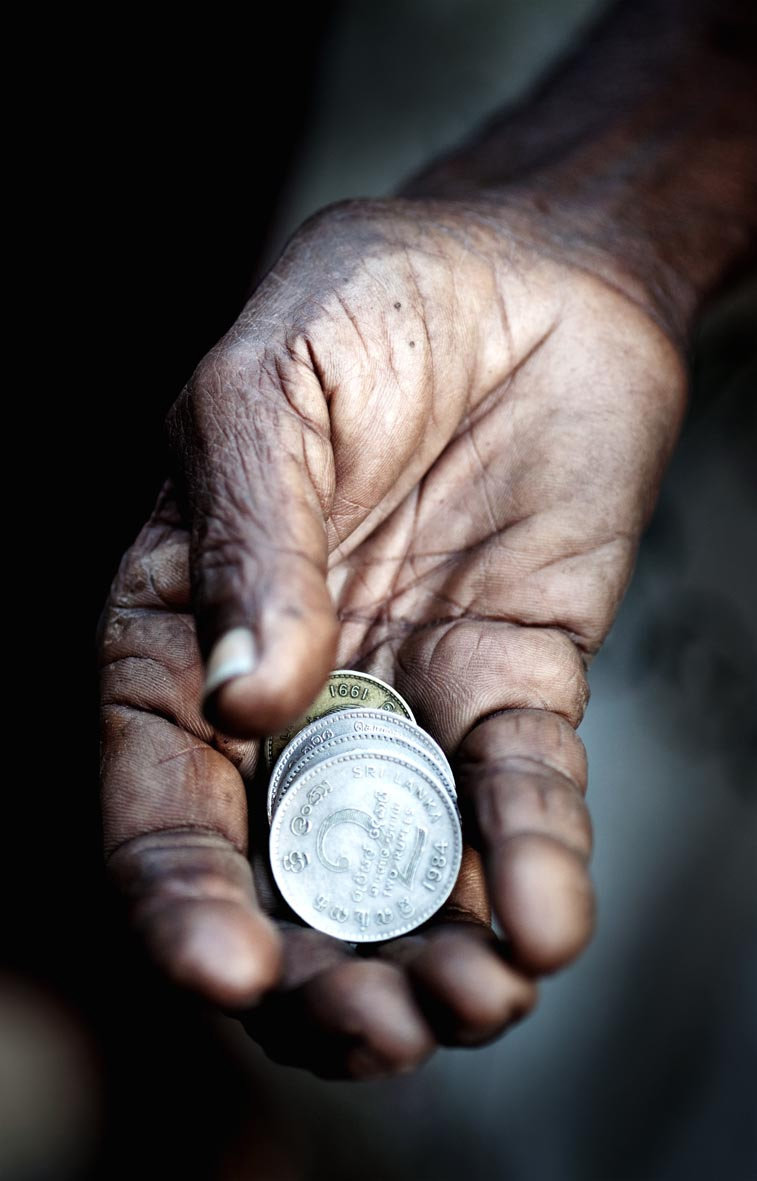 Photo of a hand with coins, taken in Sri Lanka by Phil Houghton