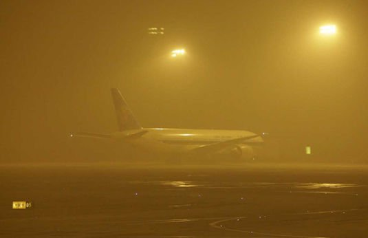 Airliner parked at Beijing Airport during the 'Airpocalypse' of January 2013