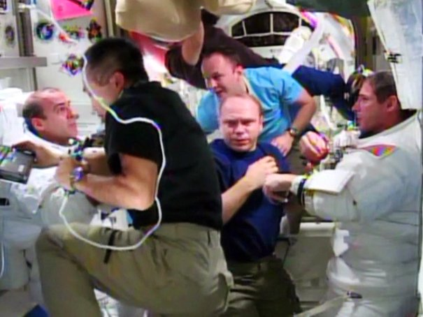 Rick Mastracchio (left) and Mike Hopkins (right) are assisted by the rest of their Expedition 38 crew mates after the completion of their Dec. 24 spacewalk