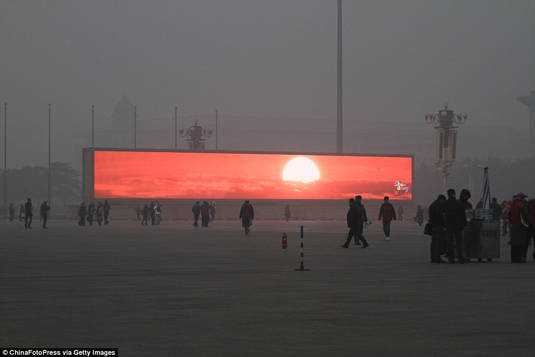 Sunset being televised in Beijing's Tiananmen Square due to heavy pollution