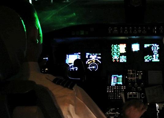 Laser blinding aircraft pilot