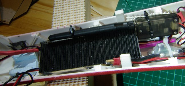 The wooden battery platform with Velcro, running down the fuse