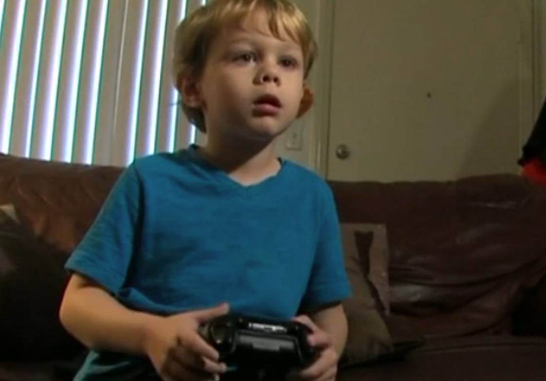 Still of Kristoffer playing on the Xbox
