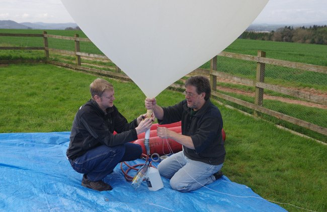 Anthony and Dave fill a balloon yesterday