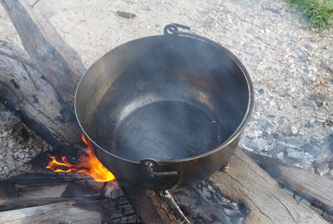 The pot on the fire during seasoning