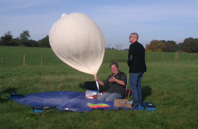 Dave filling the balloon as Heston looks on