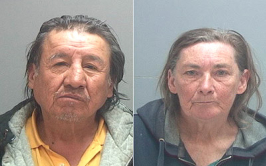 Sandra Kruser and Wilson Benally pose for police mugshots
