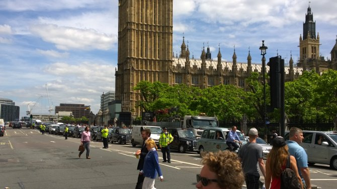 Black cabs inch over Westminster Bridge in protest against Uber