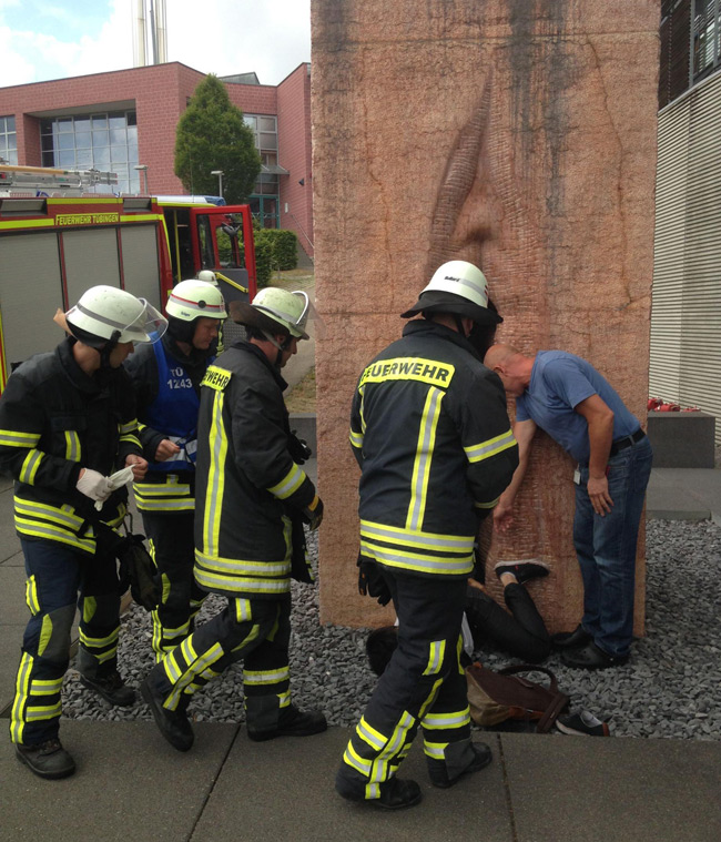 Firefighters attend the man trapped inside the giant vagina