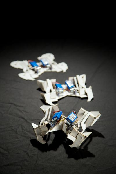 Three stages of the origami robots assembling