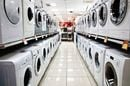 Rows of washing machines in shop aisle