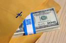 Cash in brown paper envelope CC 2.0 attribution StockMonkeys.com