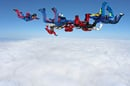 Parachutists and cloud image via Shutterstock
