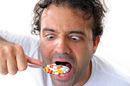 Takign medicine, image via Shutterstock