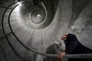 Man looking up spiral staircase inside deltalis mountain data centre