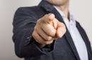Pointing finger, photo via Shutterstock