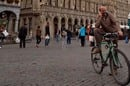 Man on bicycle talks on mobile on busy Brussels street. Photo by Alredo Cerra via Shutterstock