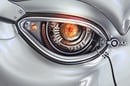Robot eye opens. Image via Shutterstock