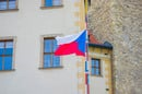 Flag of czech republic on cobbled stret in prague. Photo by Shutterstock - editorial use only