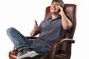 Bloke in leather chair, photo via Shutterstock