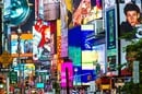 Collage of neon lights, street signs and advertisements at Times Square in New York City on June 23, 2013. Times Square holds the annual New Year's Eve ball drop. Photo by Allen G/Shutterstock for editorial use only
