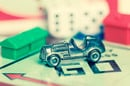 Car on Monopoly board. PHOTO BY Kamira, editorial use ONLY VIA SHUTTERSTOCK