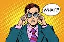 "Pop art style illustration of man exclaiming ""WHAT?"" in shock/horror/bemusement. Illustration via Shutterstock"