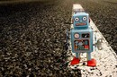 Robot on road photo via Shutterstock