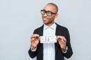 Nerd plus dollar, photo via Shutterstock