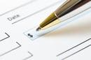 Cheque, photo via Shutterstock