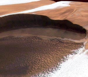 Martian north polar ice cap showing layers of water ice and dust in perspective view