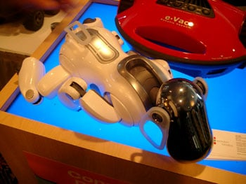 Sony's robotic Aibo dog near a robotic vacuum