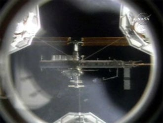 The International Space Station, as seen from the shuttle: NASA TV