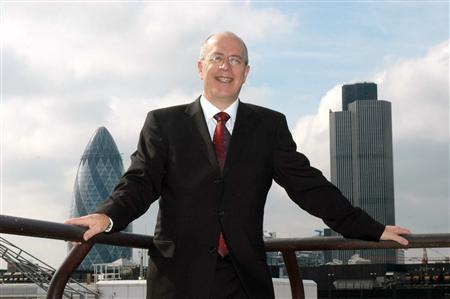 "Former BetonSports executive David Carruthers wearing suit and glasses. NatWest Tower and ""Gerkin' in background"