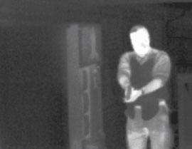 Thermal image of man with gun