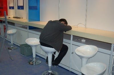 A man who has fallen asleep at an IDF booth