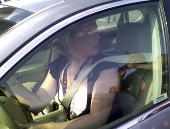 Picture of reporter in car as she drives away